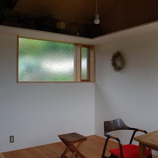 Inspiration for a zen freestanding desk medium tone wood floor and brown floor home studio remodel in Other with brown walls