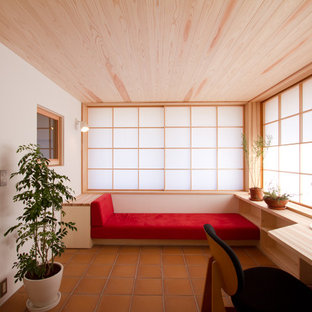World-inspired study in Other with white walls, terracotta flooring and a built-in desk.