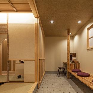 Example of a zen concrete floor and gray floor home office design in Tokyo Suburbs with beige walls