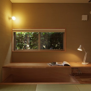 Example of a built-in desk tatami floor study room design in Other with white walls and no fireplace