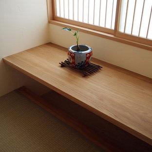 Example of a zen built-in desk tatami floor home office design in Other