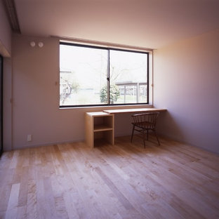 Example of a zen home office design in Other