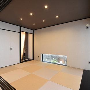 Ejemplo de despacho moderno, sin chimenea, con tatami y suelo beige