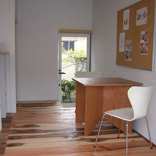 Inspiration for a small freestanding desk light wood floor and beige floor home studio remodel in Other with white walls and no fireplace