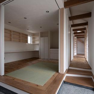 Idéer för att renovera ett orientaliskt arbetsrum, med tegelgolv