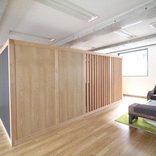 Mid-sized zen freestanding desk plywood floor home studio photo in Yokohama with brown walls