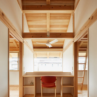 Study room - mid-sized built-in desk light wood floor and beige floor study room idea in Tokyo with white walls and no fireplace
