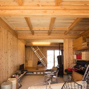 Ispirazione per una stanza da lavoro country di medie dimensioni con pareti marroni, pavimento in cemento, stufa a legna, cornice del camino in legno, scrivania autoportante e pavimento grigio