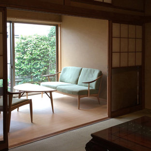 Inspiration for a small light wood floor and brown floor study room remodel in Tokyo Suburbs with green walls