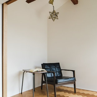 Inspiration for a huge freestanding desk medium tone wood floor and beige floor study room remodel in Other with white walls