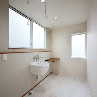This is an example of an asian laundry room in Other.