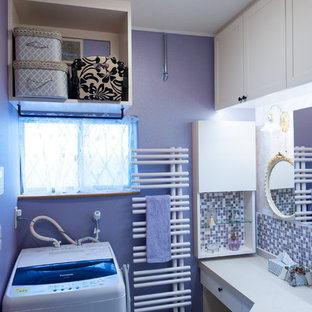 Small shabby-chic style single-wall dedicated laundry room with an undermount sink, beaded inset cabinets, beige cabinets, solid surface benchtops, purple walls, vinyl floors, an integrated washer and dryer, white floor and pink benchtop.