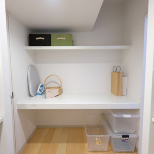 Small minimalist plywood floor and beige floor utility room photo in Other with open cabinets and white cabinets