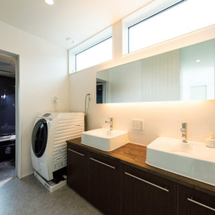 Design ideas for a mid-sized modern single-wall utility room in Tokyo Suburbs with a drop-in sink, beaded inset cabinets, brown cabinets, wood benchtops, white walls, plywood floors, an integrated washer and dryer, grey floor, brown benchtop, wallpaper and wallpaper.