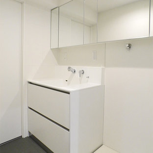 Mid-sized midcentury laundry room in Yokohama with flat-panel cabinets, white cabinets, solid surface benchtops, linoleum floors, grey floor, wallpaper and wallpaper.