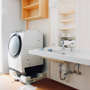 Example of a large minimalist single-wall cork floor and brown floor utility room design in Other with an undermount sink, beaded inset cabinets, brown cabinets, solid surface countertops, white walls, an integrated washer/dryer and white countertops