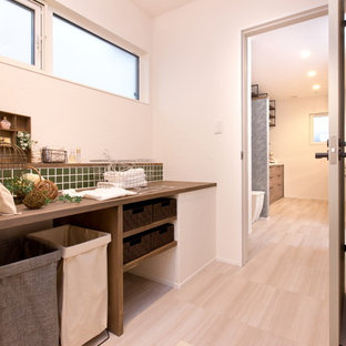 This is an example of a country single-wall utility room in Other with open cabinets, dark wood cabinets, wood benchtops, white walls and vinyl floors.