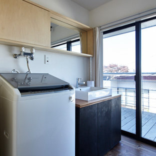 Mid-sized contemporary single-wall utility room in Tokyo with a single-bowl sink, beaded inset cabinets, light wood cabinets, wood benchtops, white walls, medium hardwood floors, an integrated washer and dryer, brown floor, brown benchtop, timber and planked wall panelling.