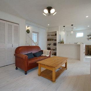 他の地域の中くらいの北欧スタイルのおしゃれなLDK (白い壁、塗装フローリング、白い床) の写真