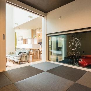 Minimalist Tatami Floor And Black Floor Living Room Photo With White Walls