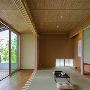 Zen formal and open concept tatami floor and green floor living room photo in Nagoya with brown walls