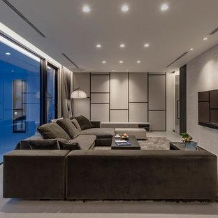 コンテンポラリースタイルのおしゃれなLDK (フォーマル、ベージュの壁、暖炉なし、壁掛け型テレビ、ベージュの床) の写真