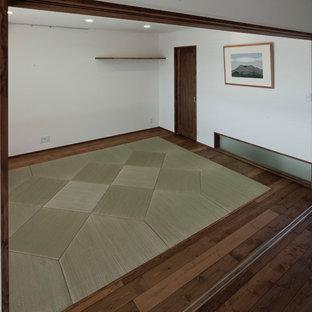 Immagine di un soggiorno etnico con pavimento in tatami