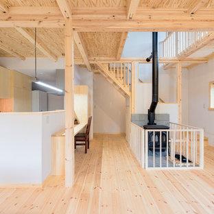 他の地域の広いアジアンスタイルのおしゃれなLDK (ライブラリー、白い壁、畳、標準型暖炉、コンクリートの暖炉まわり、白い床) の写真