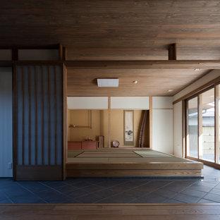 東京23区のアジアンスタイルのおしゃれなリビング (フォーマル、白い壁、テレビなし) の写真
