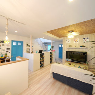 Inspiration for a beach style plywood floor and white floor living room remodel in Other with white walls and no fireplace