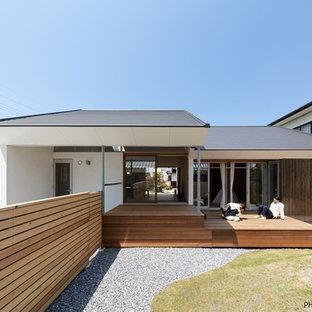 Foto di un soggiorno etnico di medie dimensioni con pareti bianche e pavimento in tatami