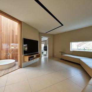 名古屋の中くらいのモダンスタイルのおしゃれなLDK (白い壁、磁器タイルの床、薪ストーブ、タイルの暖炉まわり、壁掛け型テレビ、白い床) の写真