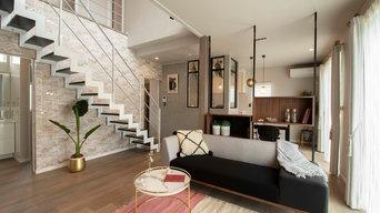 家族の笑顔あふれるリビング階段のある家
