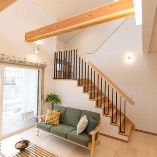 他の地域の中サイズの北欧スタイルのおしゃれなLDK (コンクリートの床、白い壁、ベージュの床) の写真