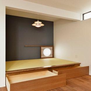 Idéer för att renovera ett orientaliskt vardagsrum, med blå väggar och tatamigolv