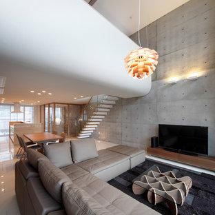 大阪の広いコンテンポラリースタイルのおしゃれなLDK (フォーマル、グレーの壁、塗装フローリング、暖炉なし、据え置き型テレビ、白い床) の写真