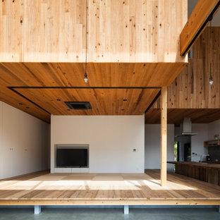 Foto di un soggiorno design aperto con pareti bianche