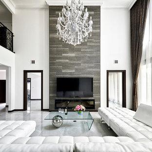 名古屋のトラディショナルスタイルのおしゃれなLDK (白い壁、壁掛け型テレビ、グレーの床) の写真