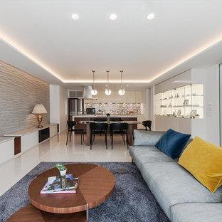 モダンスタイルのおしゃれなLDK (フォーマル、据え置き型テレビ、白い床、暖炉なし、白い壁) の写真