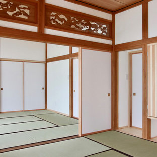 Inspiration for a medium sized world-inspired formal enclosed living room in Other with white walls, tatami flooring, no fireplace, a freestanding tv and green floors.
