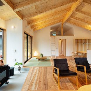 他の地域の北欧スタイルのおしゃれなリビング (コンクリートの暖炉まわり) の写真