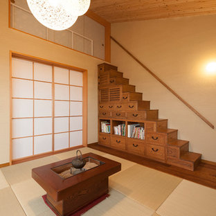 Inspiration for an asian open concept tatami floor living room remodel in Kyoto with beige walls