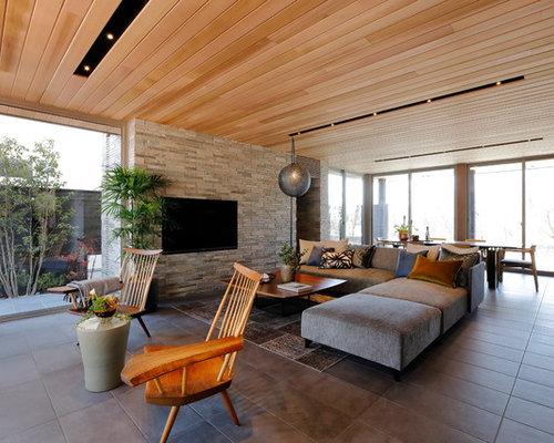 Foto e idee per living living moderno con pavimento con