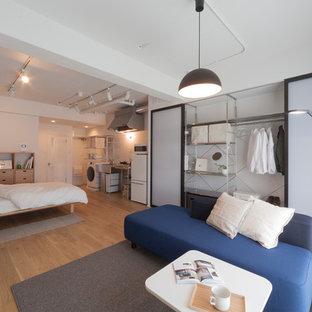 他の地域の中くらいの北欧スタイルのおしゃれなLDK (白い壁、淡色無垢フローリング、ベージュの床) の写真