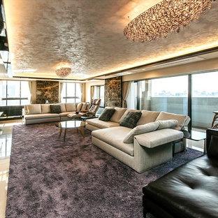 トラディショナルスタイルのおしゃれなLDK (フォーマル、マルチカラーの壁、暖炉なし、据え置き型テレビ、ベージュの床) の写真