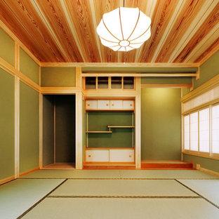 他の地域のアジアンスタイルのおしゃれなリビング (緑の壁、畳、緑の床) の写真