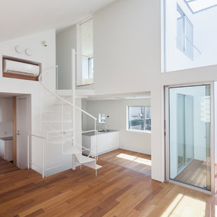 Photo of a medium sized modern formal enclosed living room in Tokyo with white walls, no fireplace, brown floors and plywood flooring.