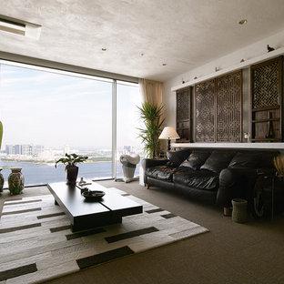 東京23区の大きいコンテンポラリースタイルのおしゃれなリビング (白い壁、カーペット敷き、暖炉なし、茶色い床) の写真