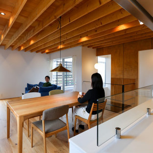 Example of a small arts and crafts formal and open concept medium tone wood floor, brown floor, shiplap ceiling and shiplap wall living room design in Other with white walls, no fireplace and a wall-mounted tv