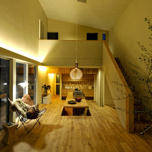 Scandi open plan living room in Other with white walls, medium hardwood flooring and brown floors.